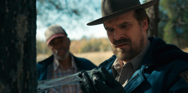 When Sheriff Hopper is called to investigate the rotten pumpkins, he finds that some of the trees in the nearby forest are covered in a strange, black, sticky residue.