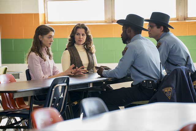 In Season 1 Nancy is questioned by the police about Barb's disappearance in the school canteen.
