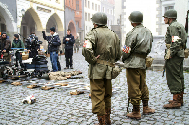 Actors waiting for the next take. The collonnades in the background are part of...