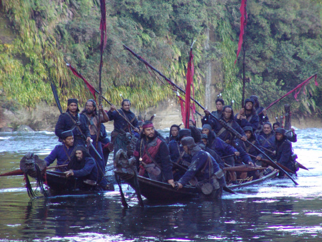 A scene from River Queen: Kupapa Warriors (colonial Maori forces) travelling downriver in their wakas (canoe).