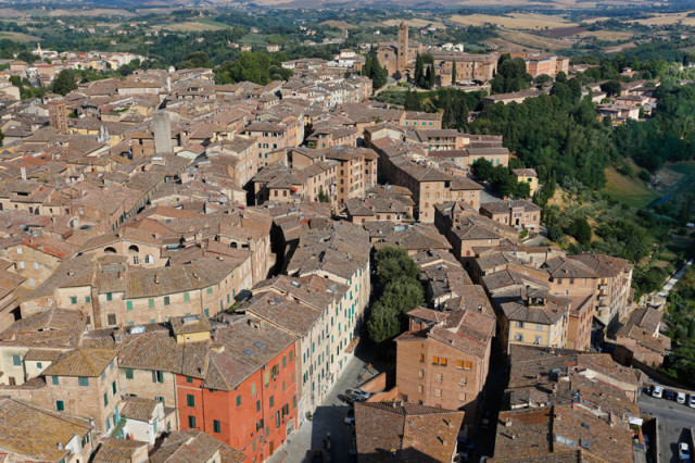 Siena, Italy - film location for Quantum of Solace. The scene with Bond jumping on balconies was filmed at Via del Rialto, located in the middle of the photo.