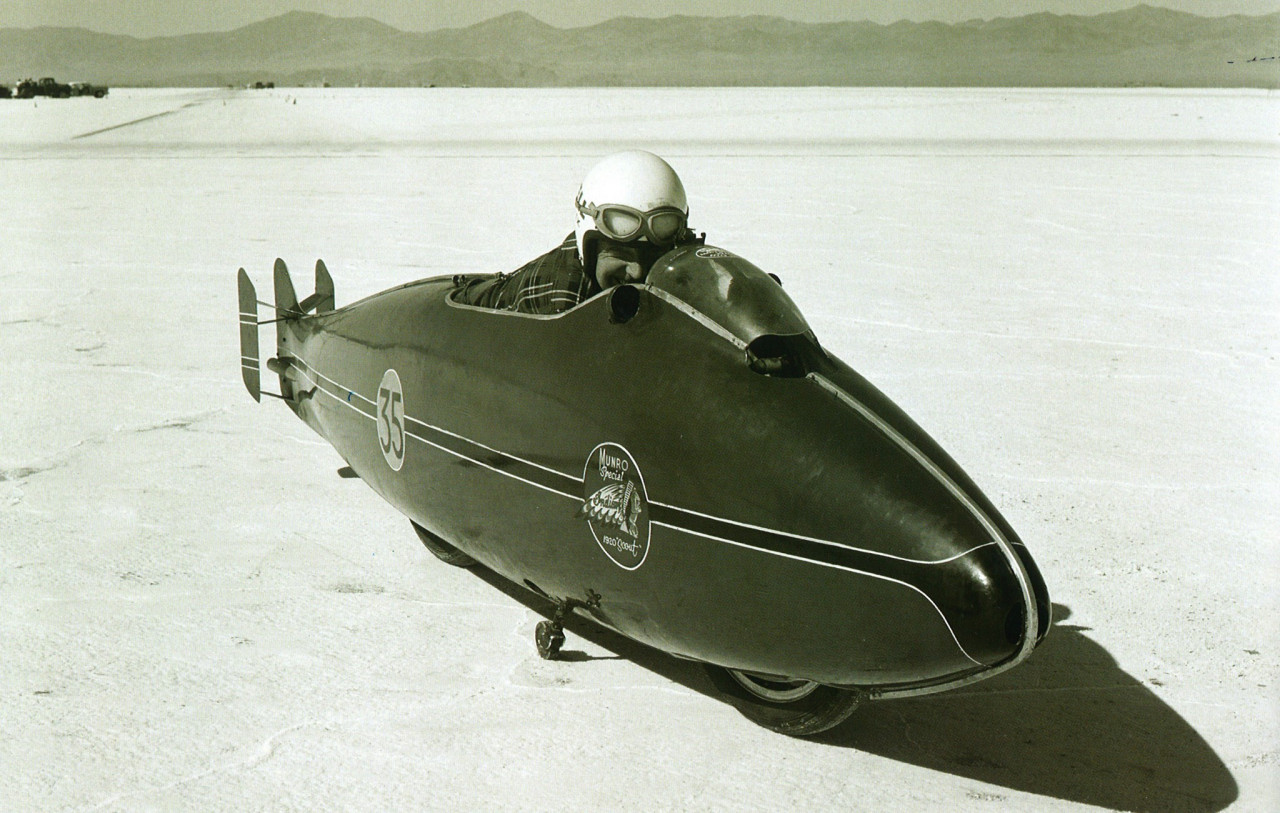 Burt Munro and his record-breaking bike, the 'Munro Special Indian Scout', at the Bonneville Salt Flats, Utah.