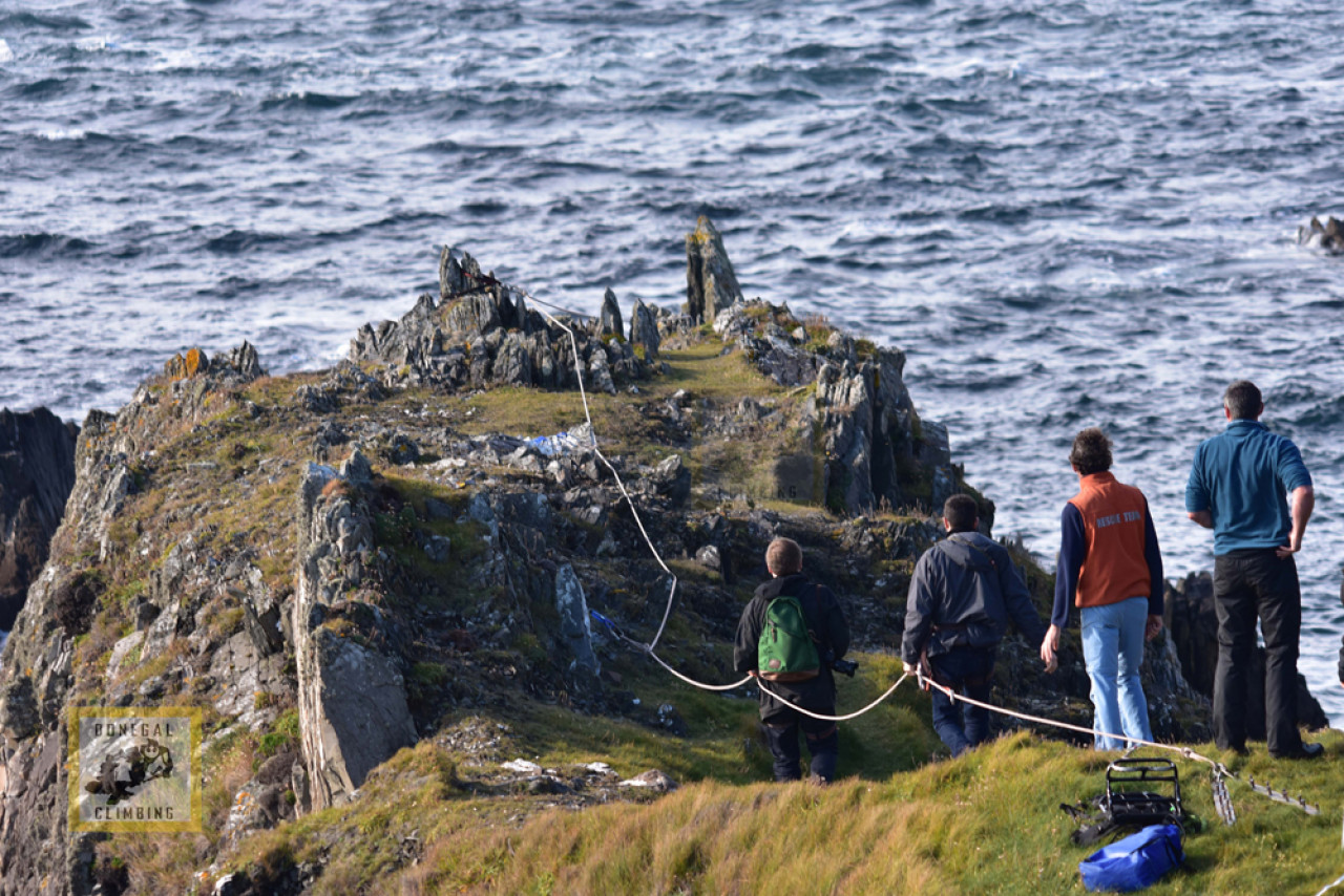 The Last Jedi Director Rian Johnson (green backpack) and Director of Photography Steve Yedlin (behind him) hold on for dear life at the Devil's Bridge, Malin Head, prior to shooting.