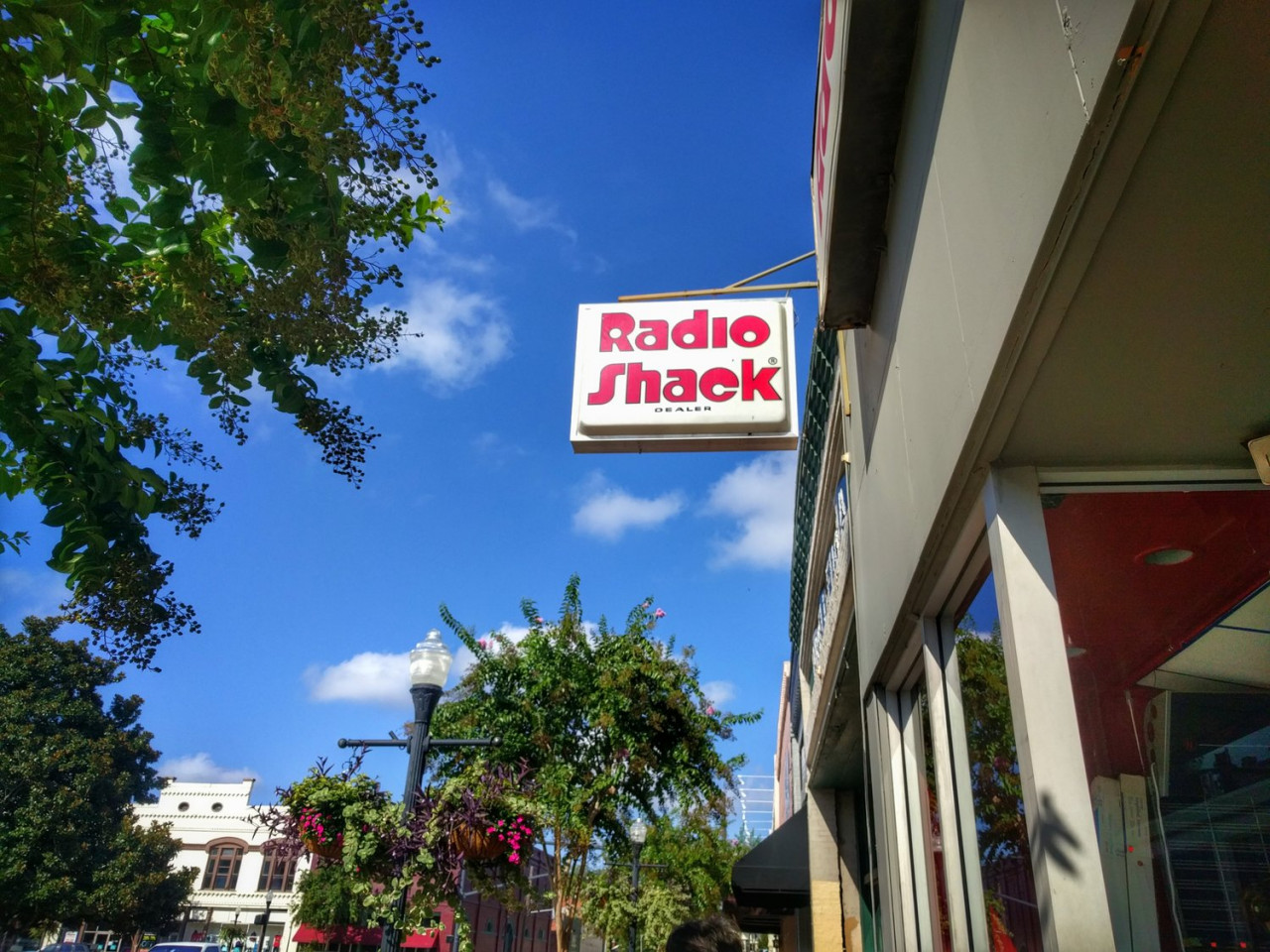 The Radio Shack is right next door to Melvald's. Believe it or not, this 80s sign is actually real and not a prop for the show!