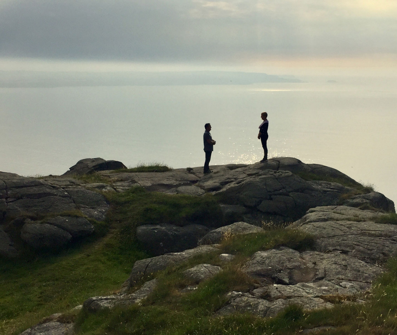 Fans on top of Fair Head recreating a scene as Varys and Melisandre from Season 7 Episode 3: The Queen's Justice.