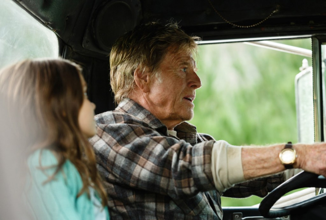 Robert Redford behind the wheel.