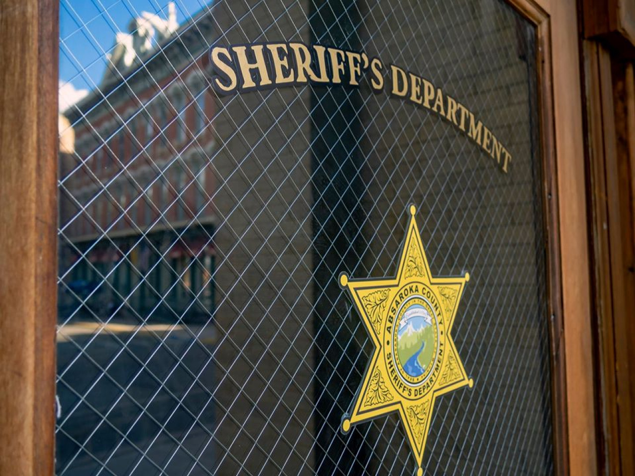 Thanks to a smart business owner, theentrance door still sports the Absaroka County Sheriff's Department badge.