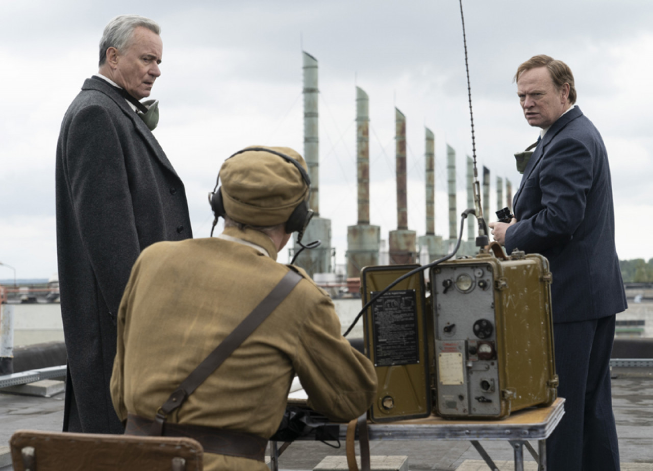 In this scene the two key figures responsible for managing the Chernobyl crisis - Minister Boris Shcherbina (Stellan Skarsgård) and Deputy Director of the Kurchatov Institute Valery Legasov (Jared Harris) - stand on the roof of the Ignalia power plant in Lithuania.
