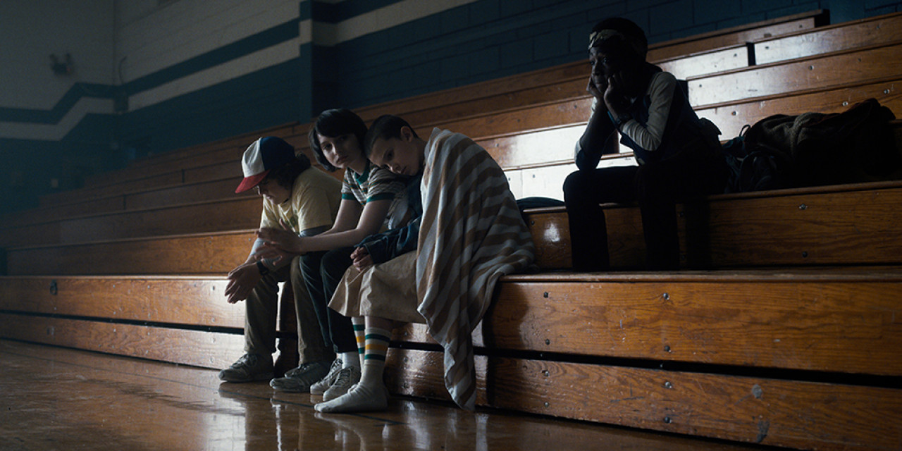 The boys and Eleven in the school gym in Season 1.