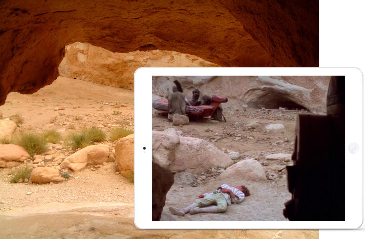 R2-D2 looks on helplessly, as the Sandpeople knock Luke unconsious and raid his landspeeder.