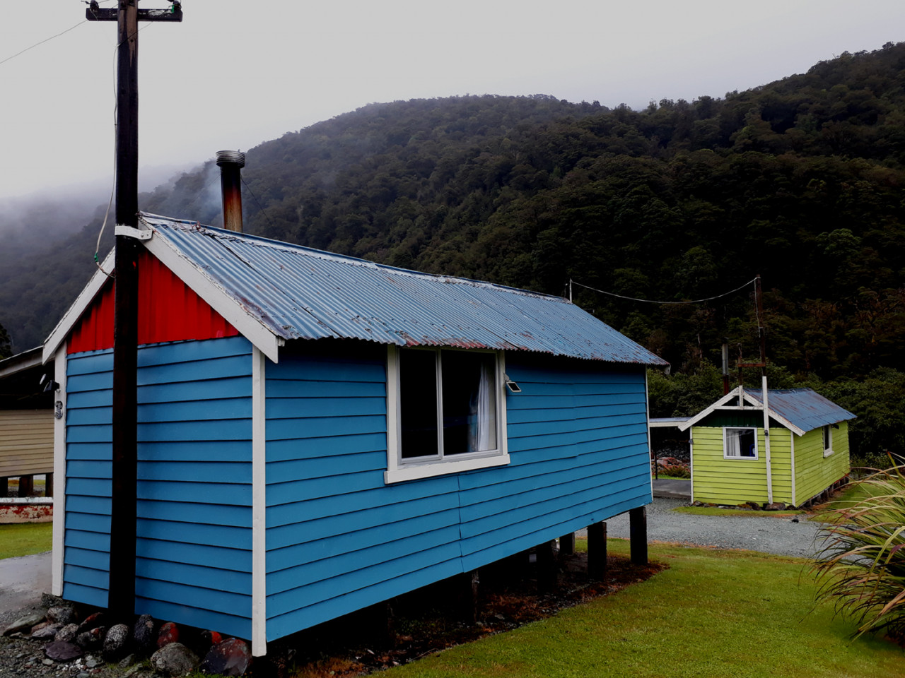 We stayed in the blue cabin in the foreground. The weather wasn't great, but when we lit our fire, it was pretty cosy.