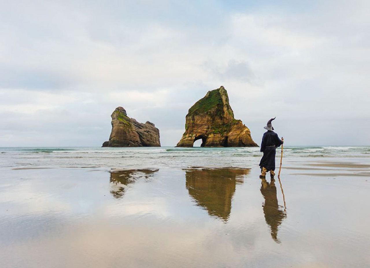 #GandalfTheGuide gets his feet wet at Wharariki Beach, New Zealand