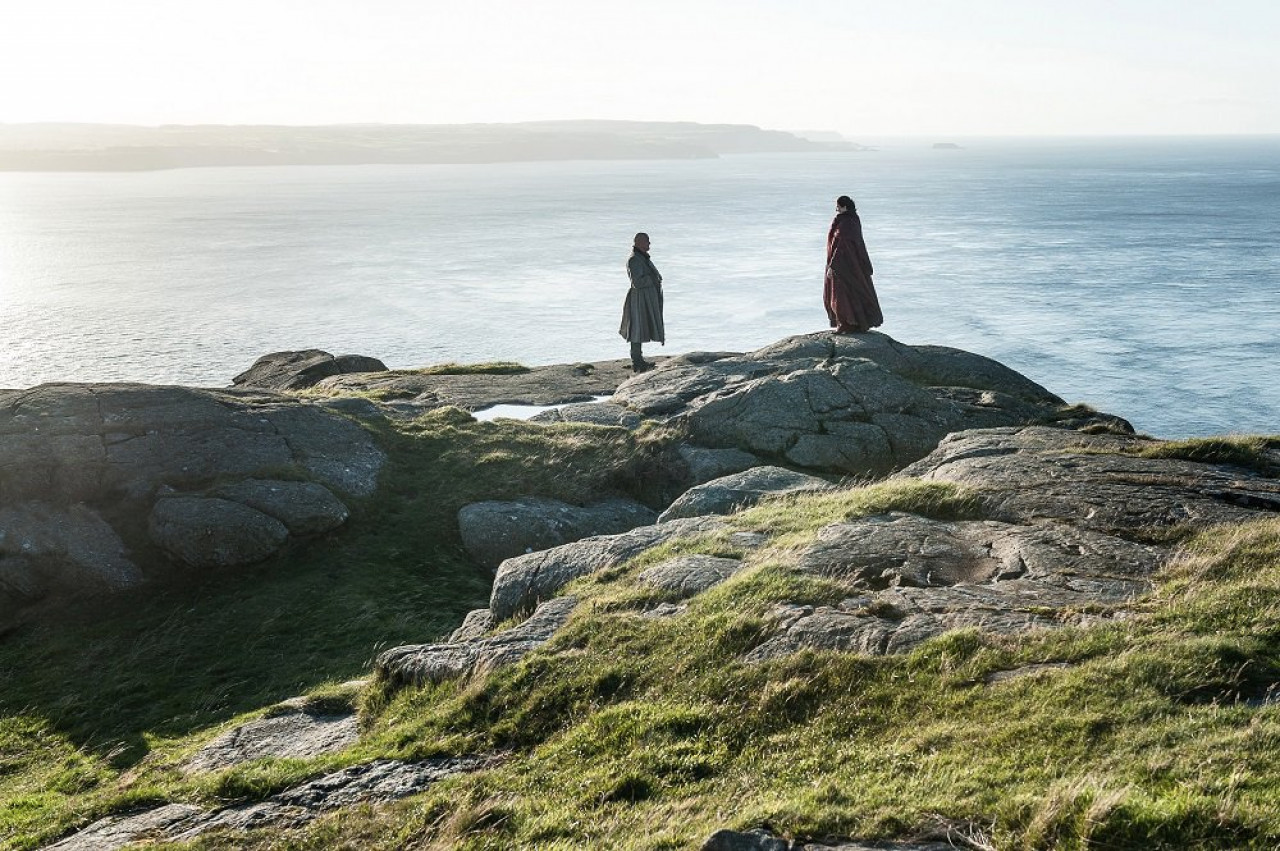 Varys and Melisandre, overlooking the Irish Sea at Fair Head (Season 7 Episode 3: The Queen's Justice.).