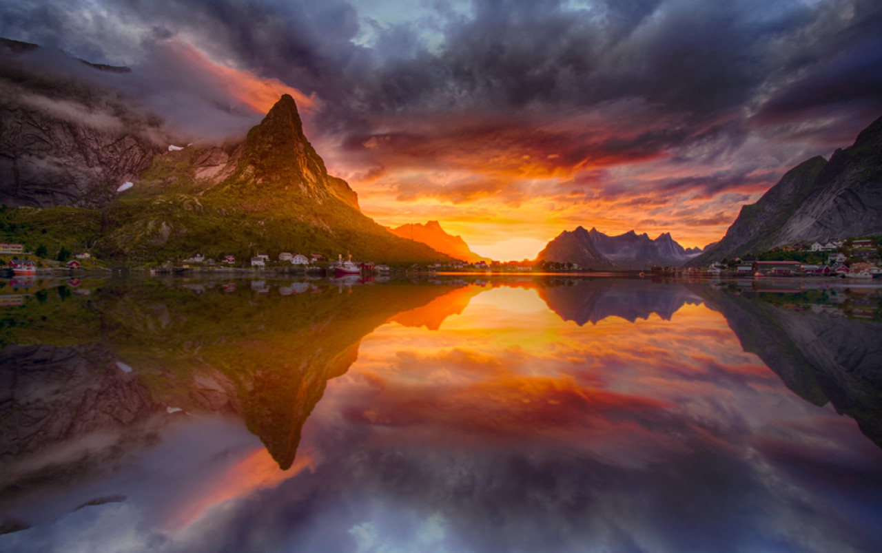 The midnight sun shining over the Lofoten Islands.