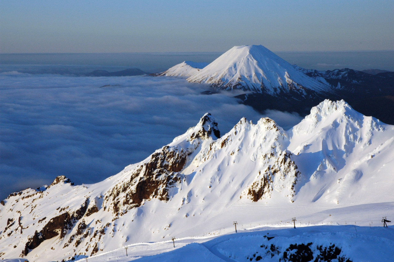 Mount Ruapehu is an active strato-volcano. The highest peak stands at2,797metres. The image above shows the Whakapapa skifield on the northern slopes of the mountain. The picture-perfect cone in the distance belongs to Mount Ngauruhoe.