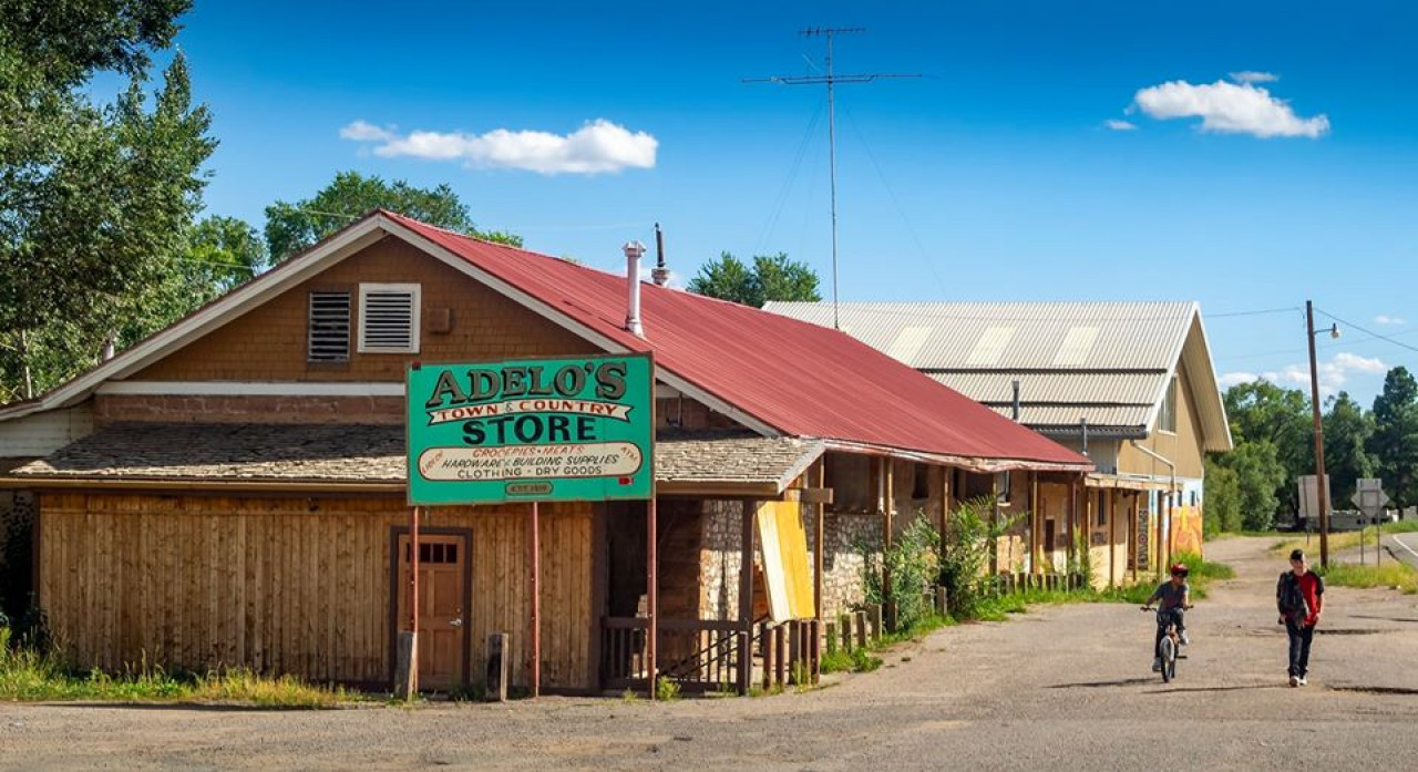 In the TV show, the bar exterior is actually the Adelo's Town and Country Store in Pecos, which is along I-25 between Santa Fe and Las Vegas, New Mexico. The store appears to be permanently closed, but sits on the main intersection in the village of Pecos. It is easily recognizable if you ignore the sign.