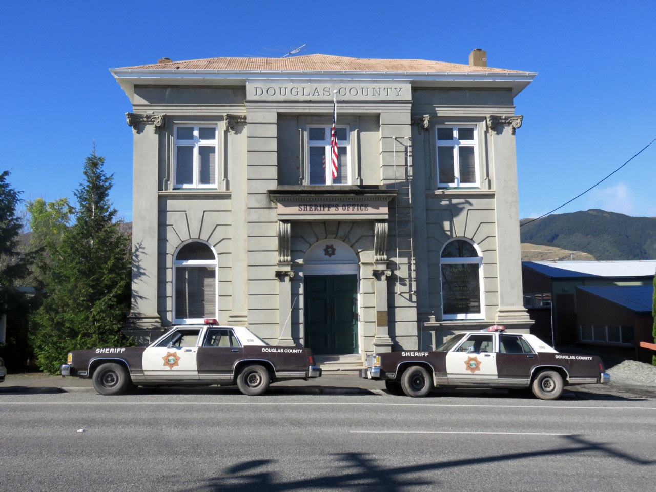 The former Bank of New Zealand building became the Douglas County Sheriff's Office (complete with American cop cars).