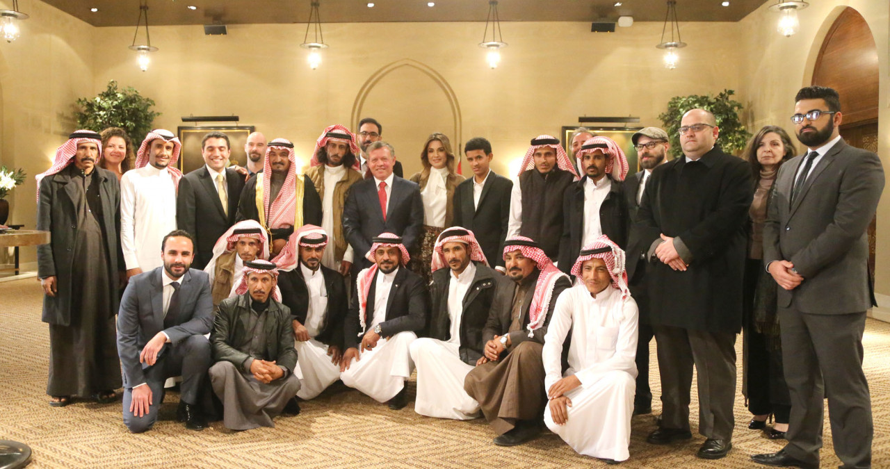His Majesty King Abdullah II (in the middle, suit with red tie),Her Majesty Queen Rania (to the King's right) and cast and crew members of Theeb. Huseen is in the first row on the far right.