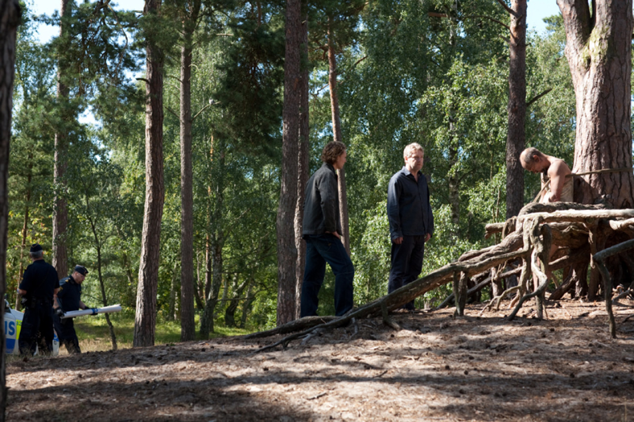 Kurt Wallander examines the crime scene in Season 2, Episode 3: The Fifth Woman.